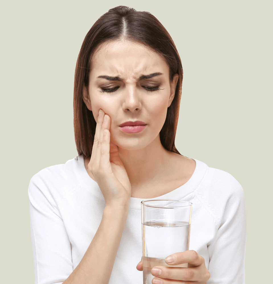 Teeth sensitivity, woman with sensitive teeth drinking glass of water